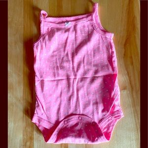Bright pink tank top body suit